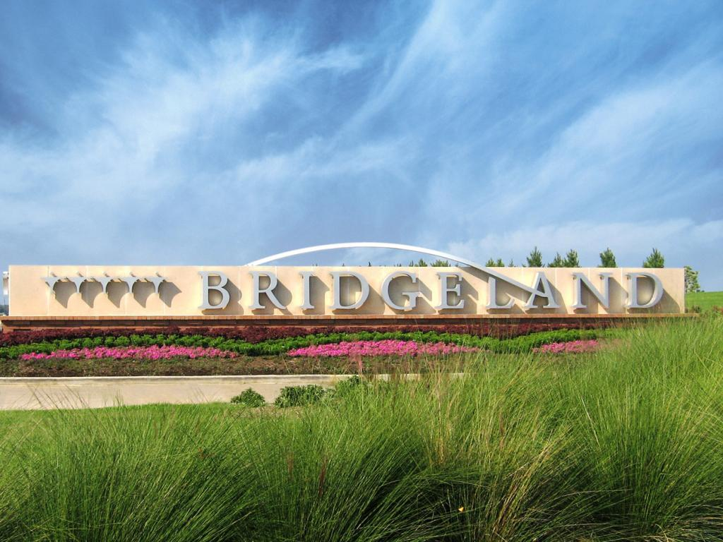 Bridgeland Project Entrance Sign with green foliage in the foreground