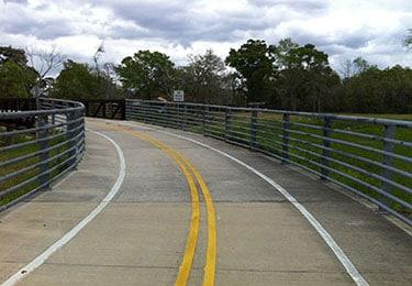 View down pedestrian/bike bridge with safety rails